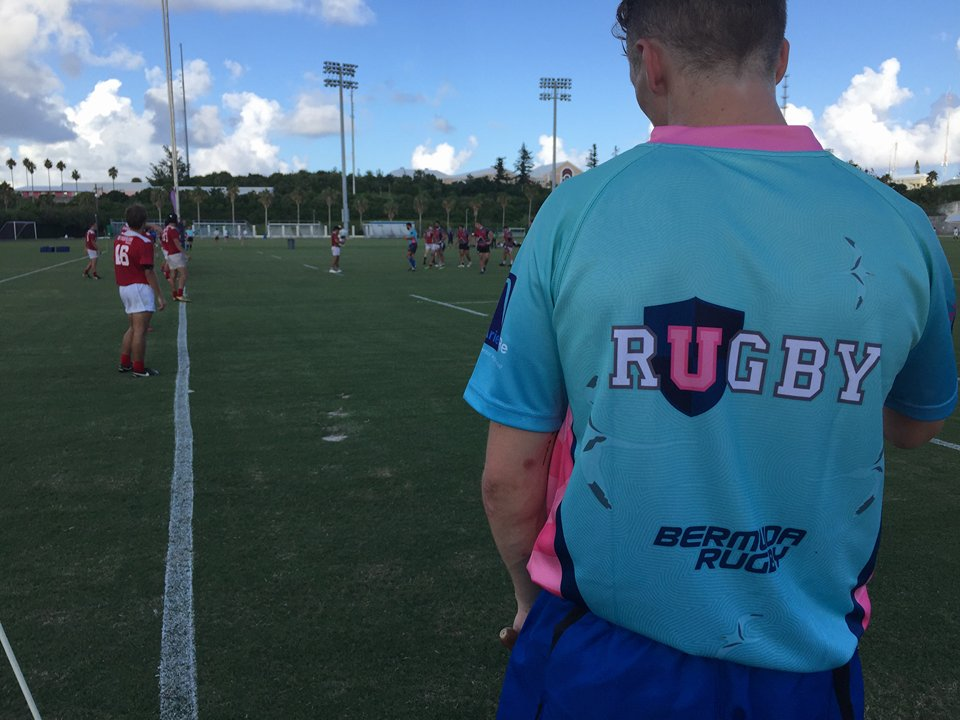 Man standing with his back to the camera wearing a URugby jersey