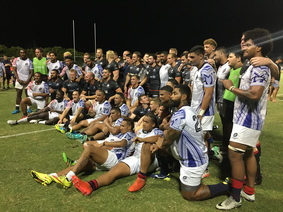 Players gathered on the rugby field for a photo