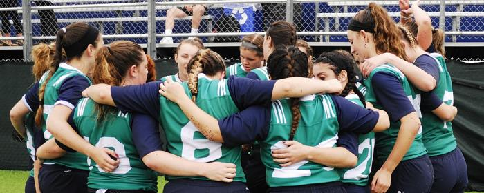 Endicott College Women 7s huddle at the half