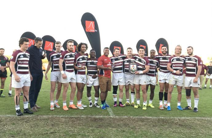 KU Winning team celebrating with their plaque