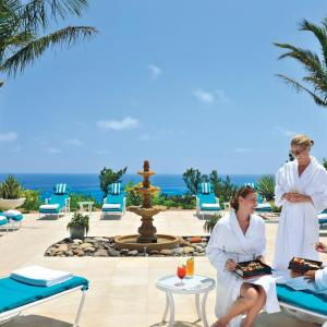 travelers relax by the pool at the fairmont in bermuda